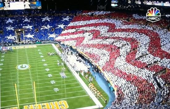 Crowd making USA flag at football game