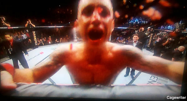 Frankie Edgar bloodies camera with celebration kiss at UFC 136