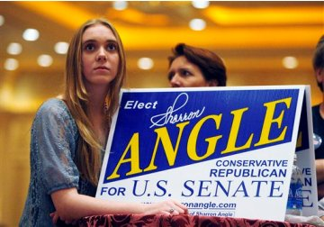 A Sharron Angle supporter holds a sign on election night.