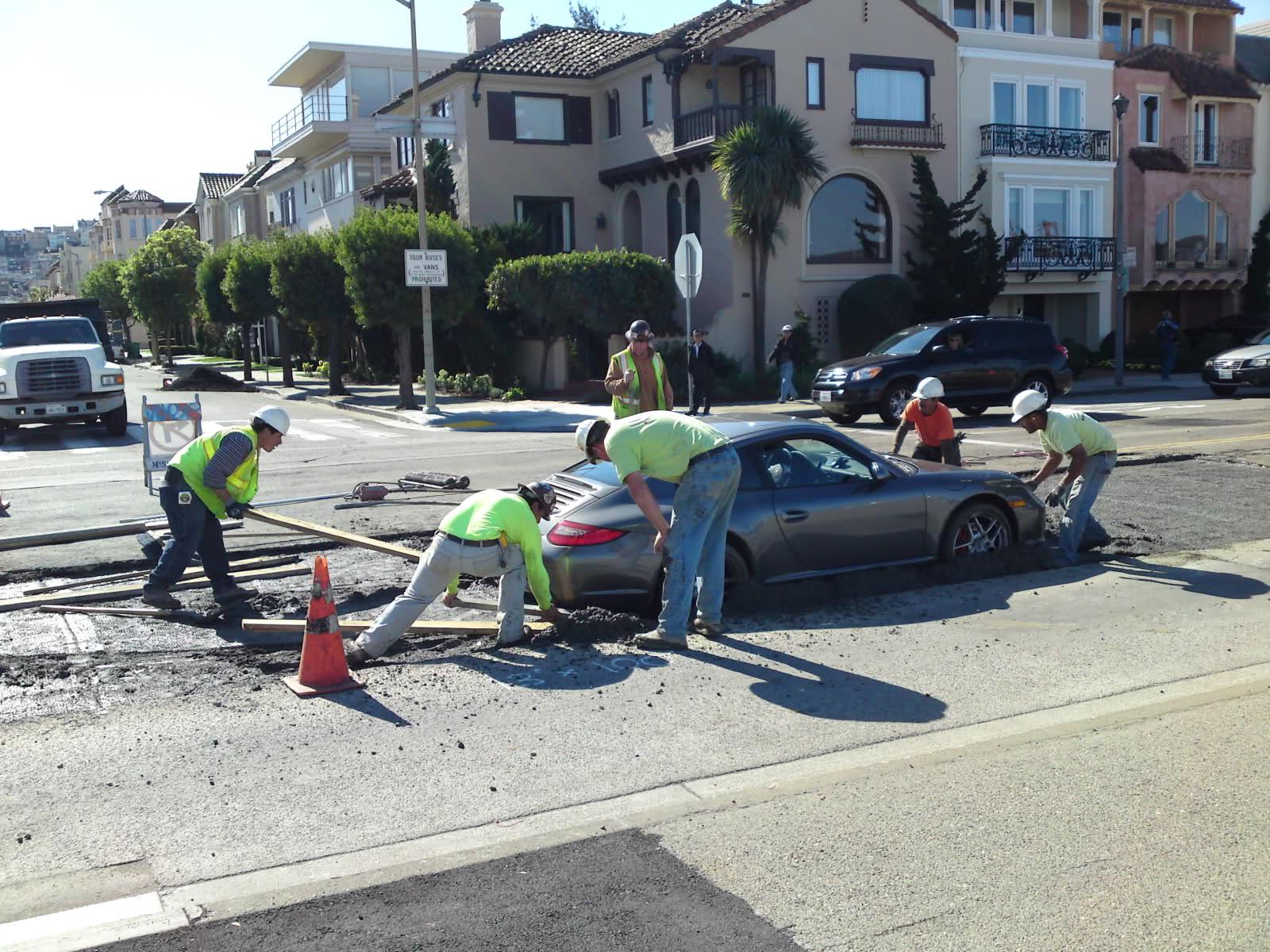 Porsche stuck in wet cement proves karma exists