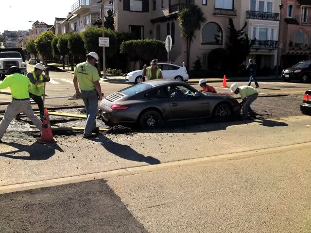 Porsche stuck in wet cement proves karma exists