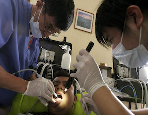In this unrelated photo, a patient receives dental treatment. (AP/Esteban Felix)