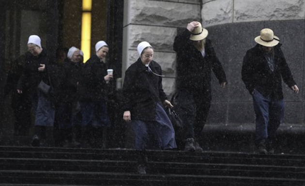 Members of Samuel Mullet's Amish community leave an Ohio federal courthouse on Friday, February 8 (Tony Dejak/AP)