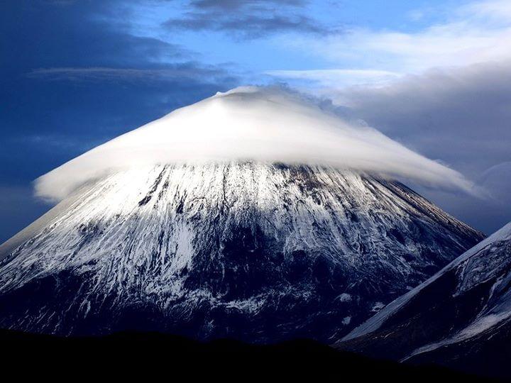 Amazing conical cloud caps Eurasian stratovolcano