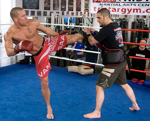 George St-Pierre, interim Ultimate Fighting Championship Welterweight Champion, spars with trainor Firas Zahabi during a training session Wednesday, March 26, 2008 in Montreal. St-Pierre will face Matt Serra April 19 in Montreal.